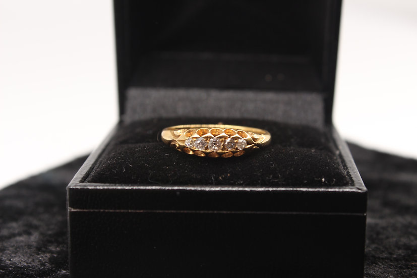 A 18ct gold diamond ring, size N, weighing 2.6g