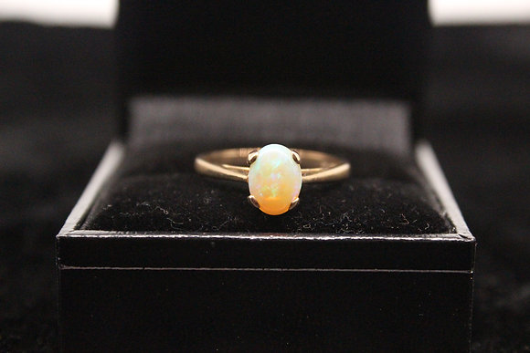 A 9ct gold ring, size O, weighing 2.0g