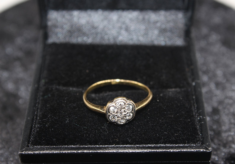 A 18ct gold diamond ring, size K, weighing 1.7g