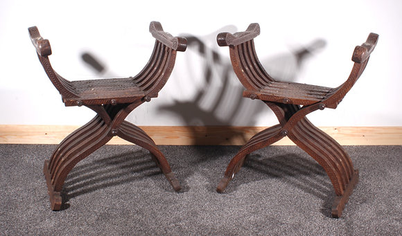 A pair of late 19th century AngloIndian hardwood X-Frame folding chairs
