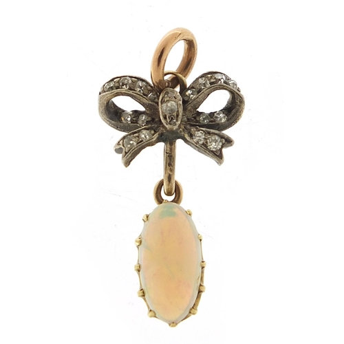 An antique unmarked gold cabochon opal and diamond pendant