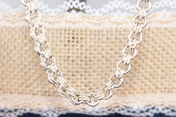 """A 1960 925 20"""" silver link chain, made by ILD LTD"""