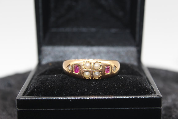 A 18ct gold, ruby & pearl ring, size Q , weighing 4.2g