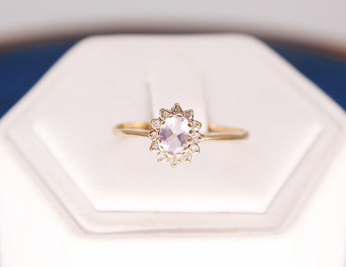 A 9ct gold & diamond ring, size Q, weighing 1.2g
