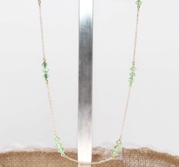 """A 9ct 16"""" gold and green stone necklace"""