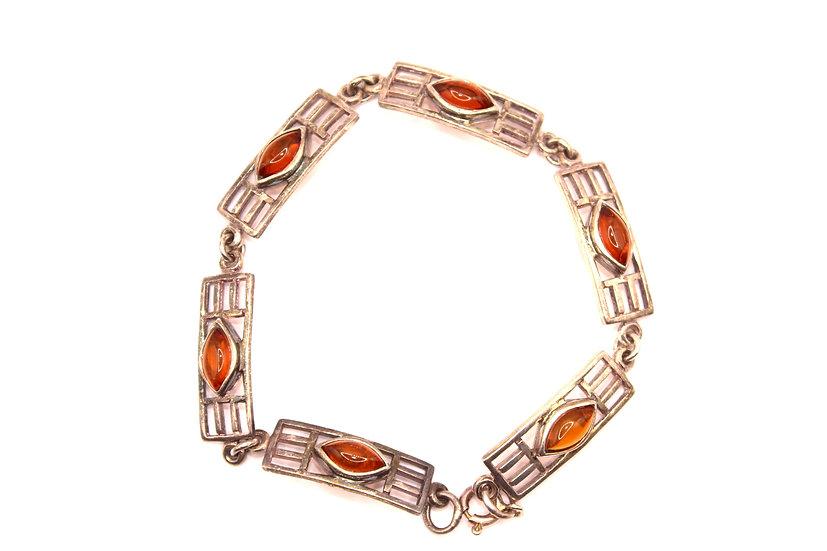 Silver rectangular link bracelet centred by an amber lozenge