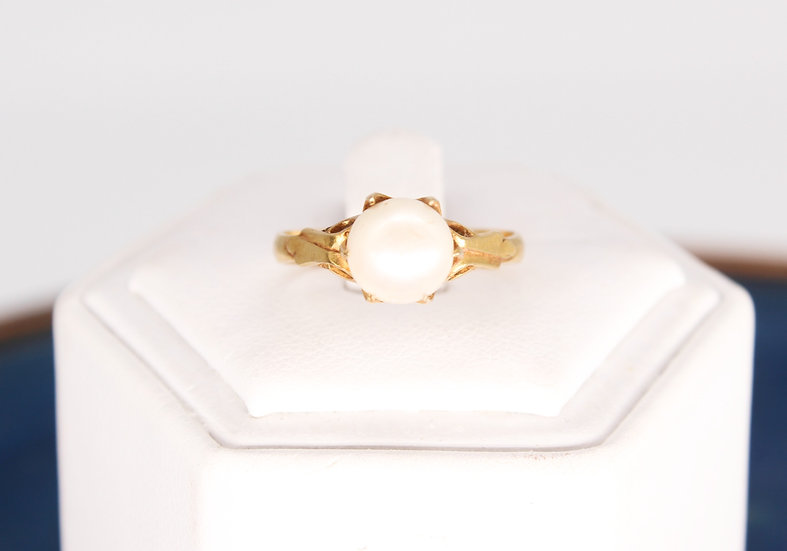A Chinese gold and simulated pearl ring, size P, weighing 2.9g