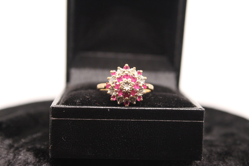 A 9ct gold, diamond & ruby ring, size M, weighing 2.2g