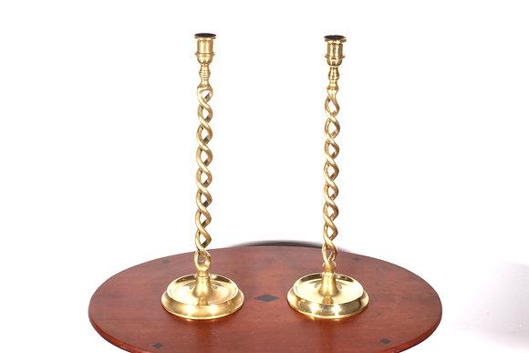A pair of tall Victorian brass double pierced twist candlesticks