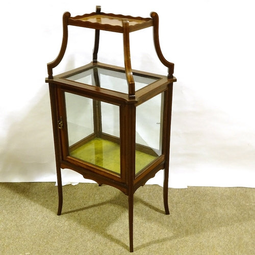 An Edwardian mahogany centre standing display cabinet with shelf above