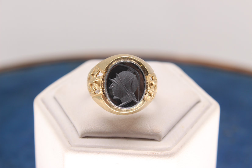 A 9ct gold ring, size P, weighing 5.9g