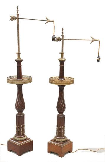 A pair of Dreyfous mahogany & ormolu floor standing lamps in Louis XVI style