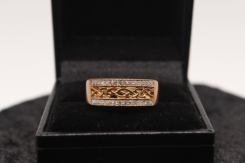 A 9ct gold diamond ring, size N, weighing 3.4g with certificate