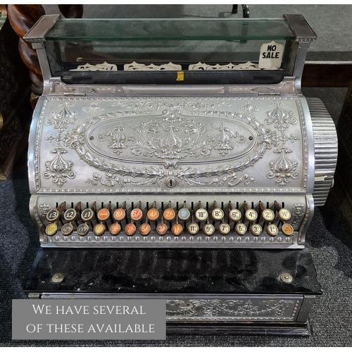 A chrome National cash register No 357, serial no 61958, on black plinth base
