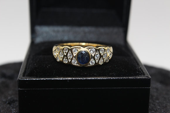 A 18ct gold, diamond & sapphire ring, size U, weighing 4.6g