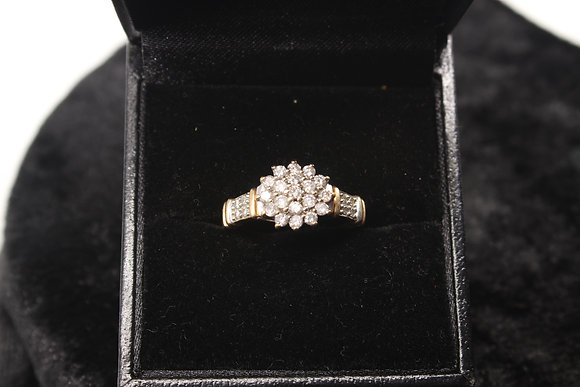 A 9ct gold diamond ring, size M, weighing 2.5g