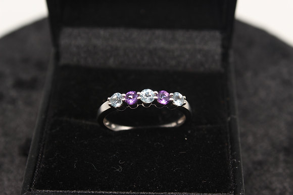A 9ct gold, topaz & amethyst ring, size P, weighing 2g