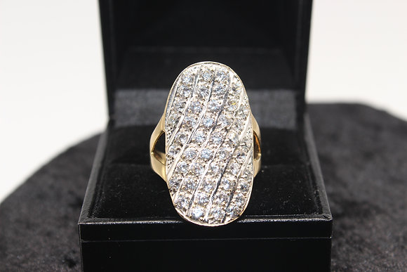 A 9ct gold ring, size T, weighing 7.1g
