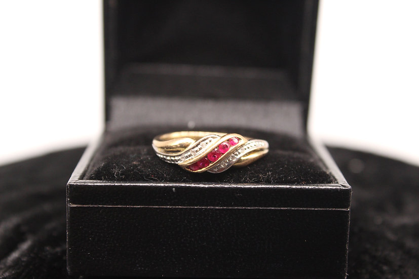 A 9ct gold and diamond ring, size P, weighing 2.1g
