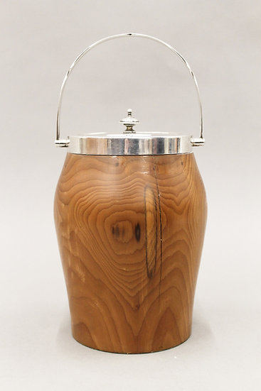 An early 20th century silver mounted yew wood biscuit barrel