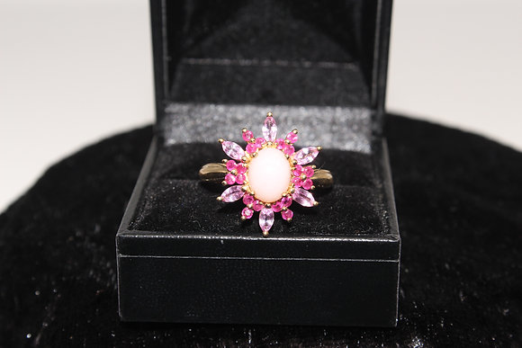 A 9ct gold, opal & pink topaz ring, size O, weighing 4.0g