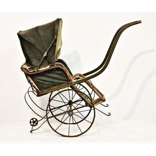 A late 19th to early 20th century doll stroller rickshaw pram