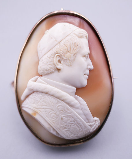 A 19th century unmarked gold framed cameo brooch carved as Pope Pius IX, signed