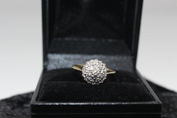 A 9ct gold diamond ring, size K, weighing 2g