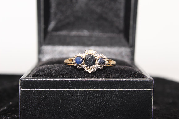 A 9ct gold and topaz ring, size N, weighing 1.9g