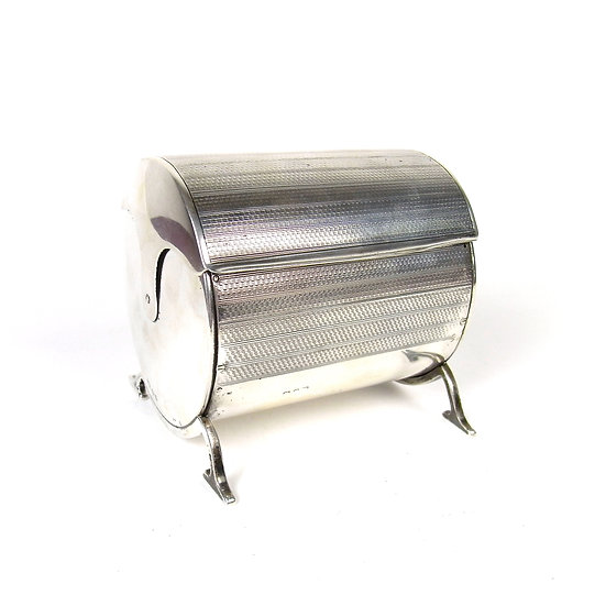 An unusual George V silver revolving tea caddy