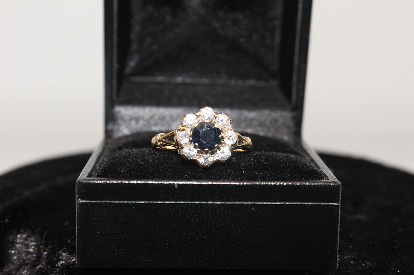 A 9ct gold and topaz ring, size N, weighing 2.6g