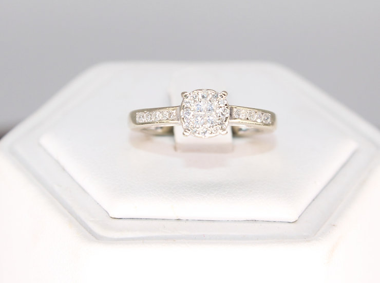 A 9ct gold & 25 PTS diamond ring, size L, weighing 2g