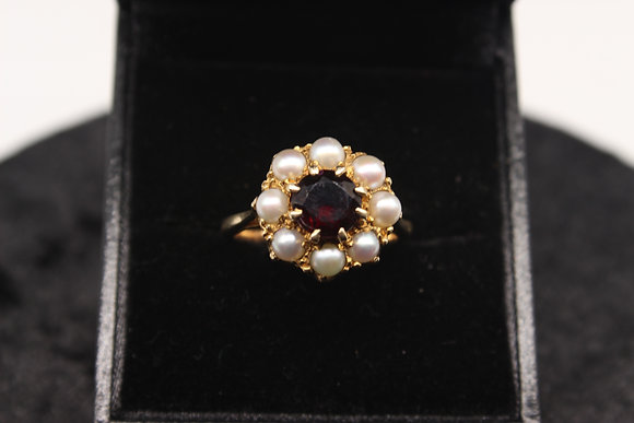 A 9ct gold, garnet & pearl ring, size K, weighing 4.6g