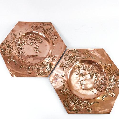 A pair of Art Nouveau copper plaques