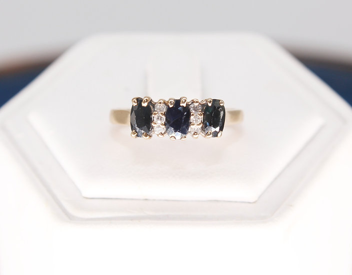 A 9ct gold, topaz & diamond ring, size M, weighing 1.8g