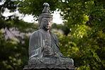 Canva - Buddha Statue Near Trees by Alek