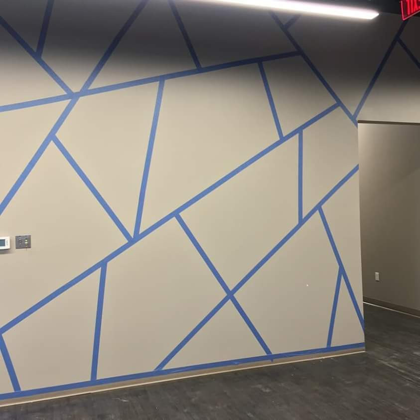ScotchBlue painter's tape outlines the shapes of this Sherwin Williams painted accent wall