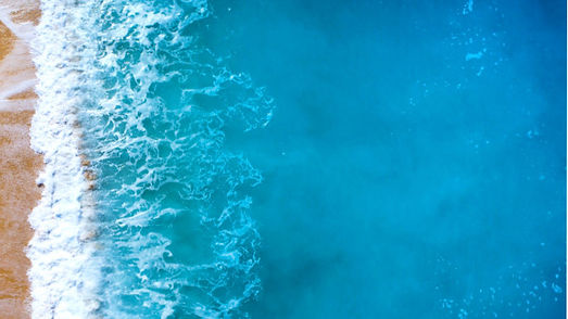 aerial-view-of-waves-of-clear-turquoise-