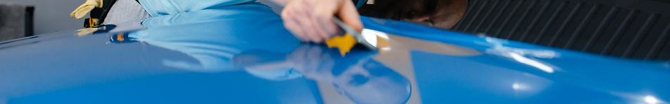 car-wrapper-with-squeegee-installs-prote