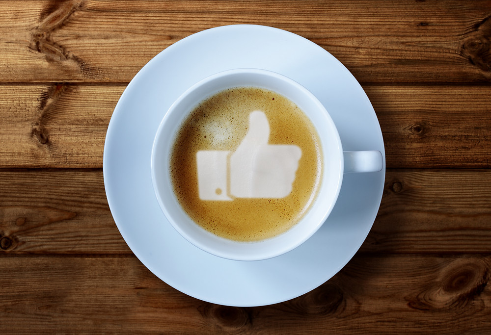 Thumbs up or like symbol in coffee froth.jpg