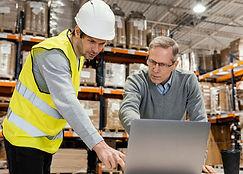 men-warehouse-working-laptop.jpg