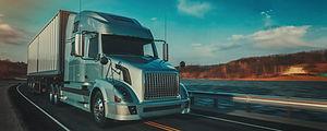 blue-truck-running-road.jpg