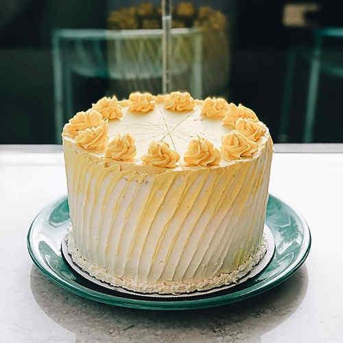 Lemon cake with lemon curd and lemon but