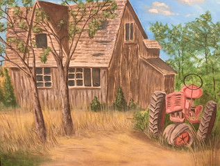 Deserted farm and tractor