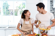 Couple attending live online cooking classes