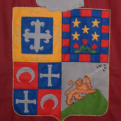 Tapiz con escudo del apellido cosido a mano