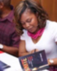 Kelly signing book.jpg