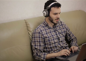 a-handsome-guy-in-headphones-working-on-