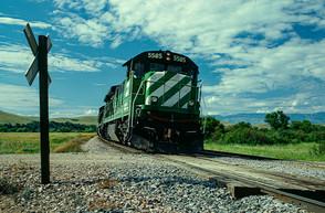 BN GE C30-7 #5585 leads a northbound unit coal train down the Pass Creek/Little Bighorn Valley near Aberdeen, MT