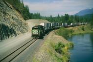 Two Burlington Northern SD40- 2's lead eastbound freight along Kootenai River near Yakt, Montana West of Troy, MT
